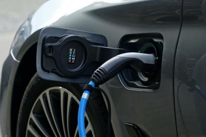 An electric car recharging its battery